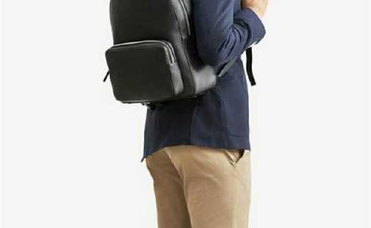 万宝龙双肩包:荔枝纹牛皮耐磨防刮,宽肩带设计背负舒适