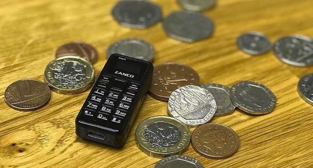 全世界最袖珍手机:比拇指小比硬币轻,售价398元