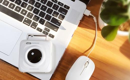 不用墨水的热敏打印机,迷你大小携带方便