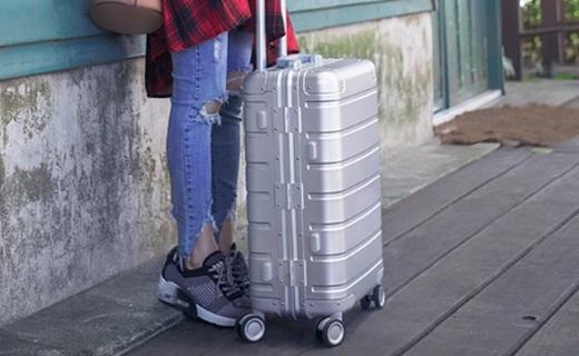 小米90分旅行箱:双轴承静音万向轮,灵动自如超坚固