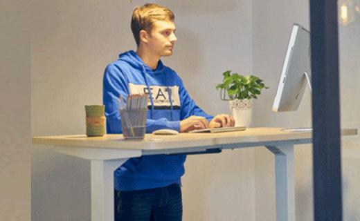 9-A-M智能升降桌:人体工学舒适办公,手机遥控高度随心可控