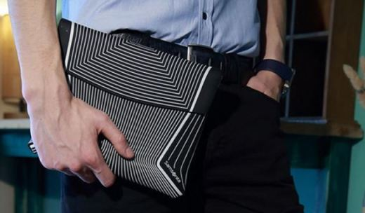新秀丽电脑包:防震棉材质保护设备安全,结构主义图案时髦炫酷
